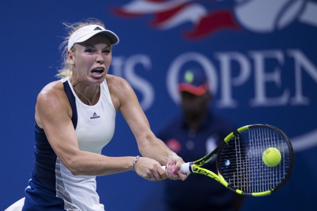 Ruthless Wozniacki, Cilic into Open quarters