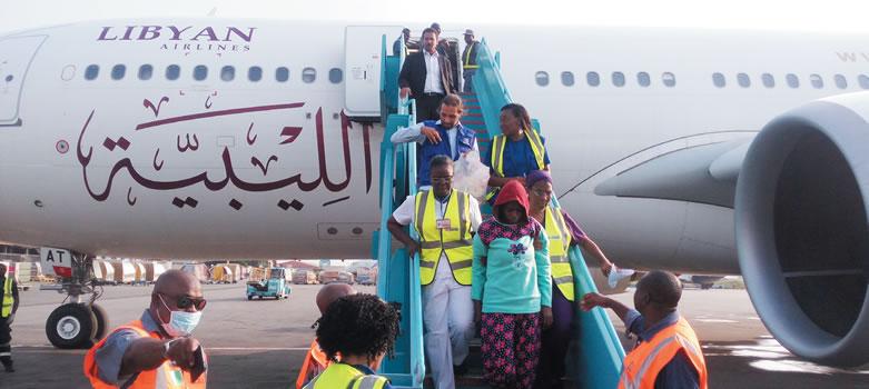 [PHOTO] Nigerian Libya returnee gets emotional, kneels on the tarmac in thanksgiving