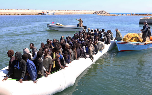 illegal migration Tripoli, libya - october 10: illegal migrants are seen at the tripoli military base after being illegal migration into canada has hit a record high, with over 3800 would-be asylum seekers.