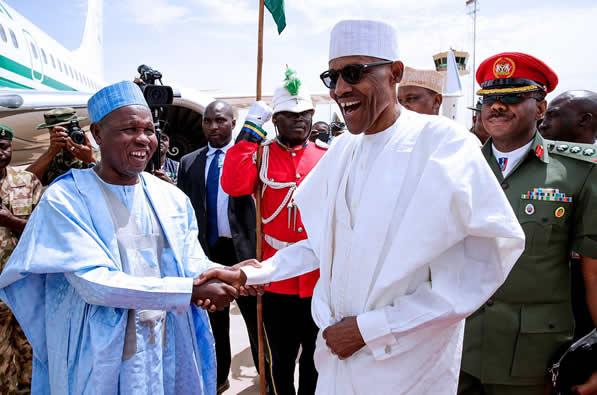 PHOTOS: Buhari arrives Abuja with wife