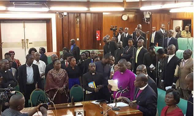 PHOTOS: Uganda Parliament members invite clerics to sanitise house