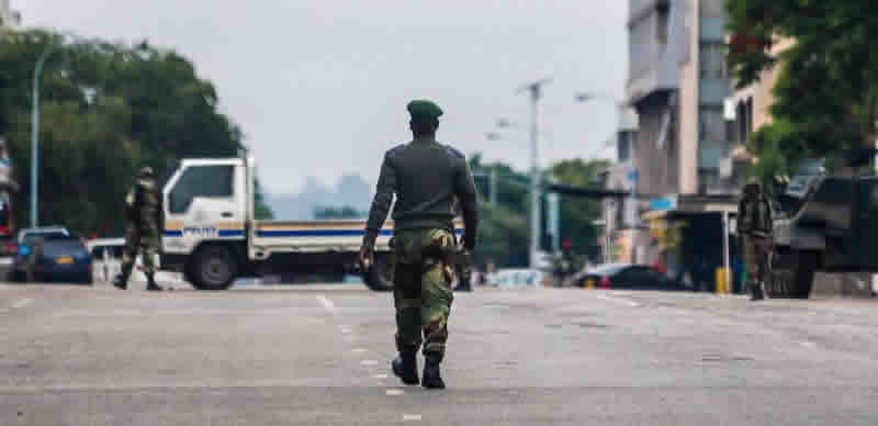 [PHOTOS] Military vehicles block road outside Zimbabwe parliament