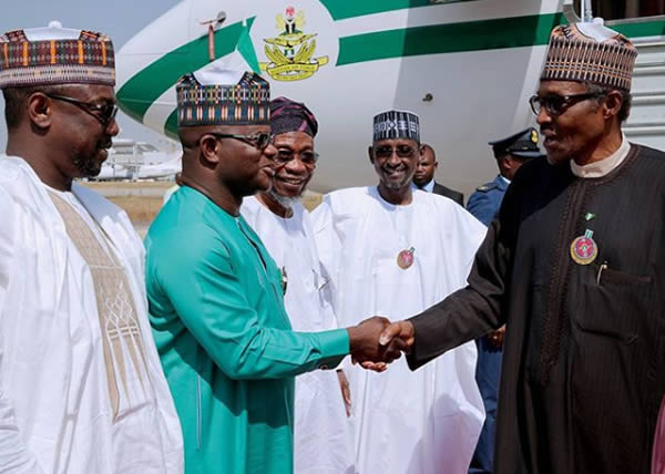 PHOTOS: Buhari arrives Abuja from Jordan