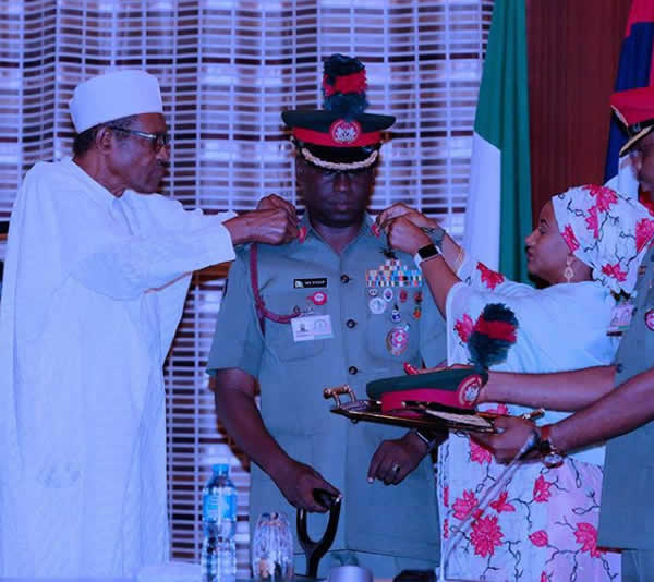 PHOTOS: Buhari decorates Guards Brigade commander in Abuja