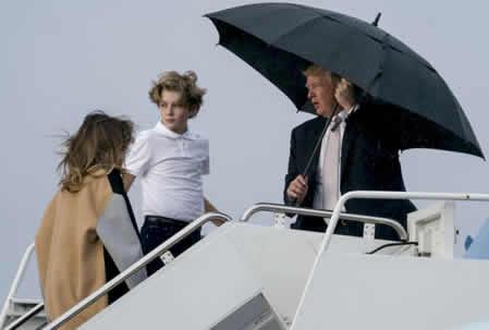 [PHOTOS] Trump keeps umbrella to himself, as Melania gets soaked