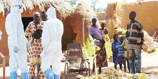 Ebola team visiting a traditional healer whose family lost several members to Lassa fever. Photo: WHO.