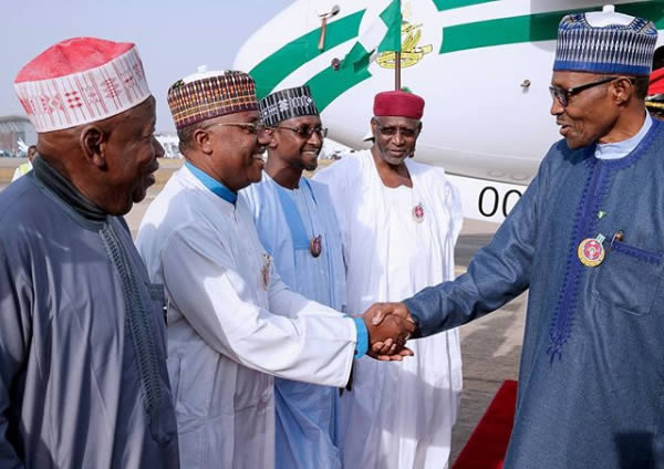 PHOTOS: Buhari returns from Paris