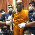 PHOTOS: Dead monk found smiling two months after
